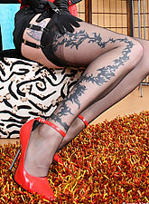 Amazing Nadja posing at shoe chair in hot back nylons and red corsage