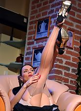 Leggy brunette lady in sheerest vintage nylon stockings and retro underwear
