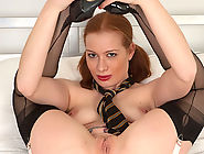Ruby Red, suspended in her stockings and suspenders, amusing herself just like the bad girl she is